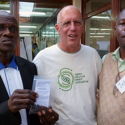 Jack Kloppenburg (OSSI, USA) shares OSSI-Pledged seed (Beefy Resilient Grex beans, bred by Carol Deppe) with Ugandan farmer Geoffrey Mugarura and John Mulumba (Plant Genetic Resources Center, Uganda)